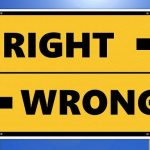 Integrity right and wrong sign photo